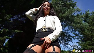 Bootyful chick shows off her wet pussy upskirt pulling panties aside