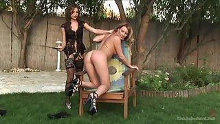 Rough back yard lesbian pleasures in a kinky femdom