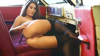 Eva Lovia in sexy lingerie masturbates in the retro car