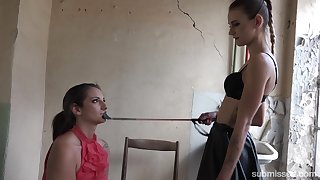 Skinny wicked mistress dominates a slave bigger than her