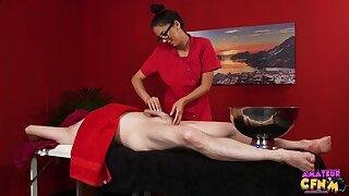 Julia De Lucia massages a lad's cock and makes him bust a nut