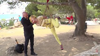 Kinky slut Liz Rainbow loves being tortured by a perv in outdoors