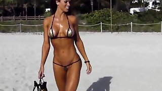 Extreme short bikini cameltoe fetter on beach