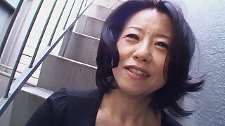 Horny Japanese granny Junko Sakashita spreads her legs to be dicked