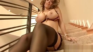 Busty Garter Belt Milf Shows Off On A Staircase