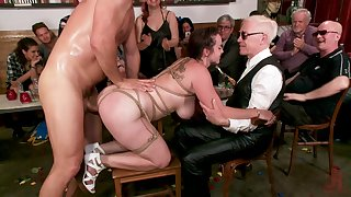 Buxom redhead MILF Bella Rossi pounded in bondage in front of people